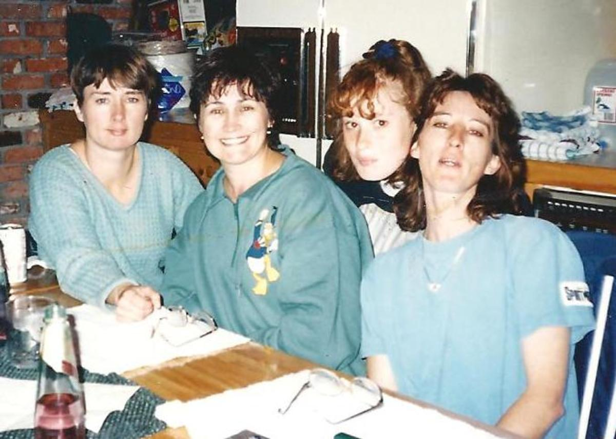My sisters and I and my niece about 1995. Me at the far left, then Chris, Jamey at the far right, niece Michelle behind.