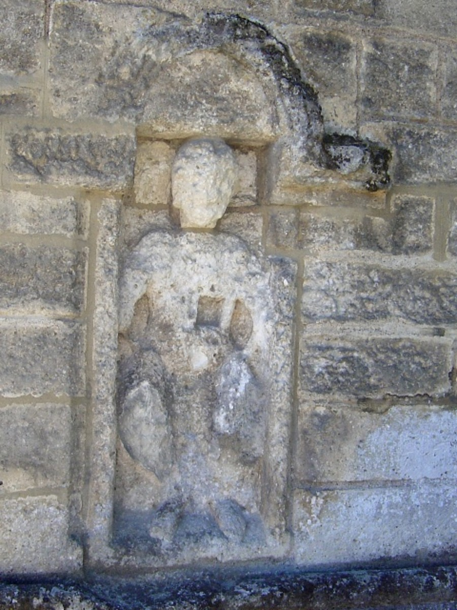Carvings on the walls of the Brantome abbey church