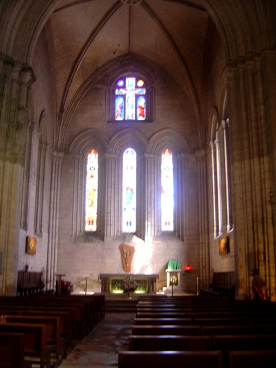 Inside Brantome abbey church the windows of the east end stream with light