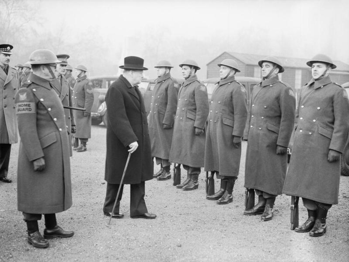 There were 50 - 60 Americans who volunteered. Winston Churchill inspects the American Squadron of the Home Guard. US Ambassador, Joe Kennedy (JFK's father and no real friend of the British), said this gave the Germans an excuse to execute Americans.