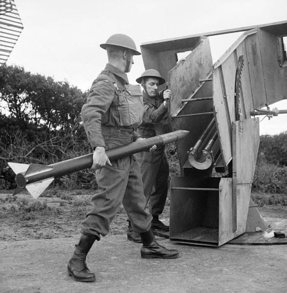 WW2: Home Guard soldiers load an anti-aircraft rocket at a 'Z' Battery.