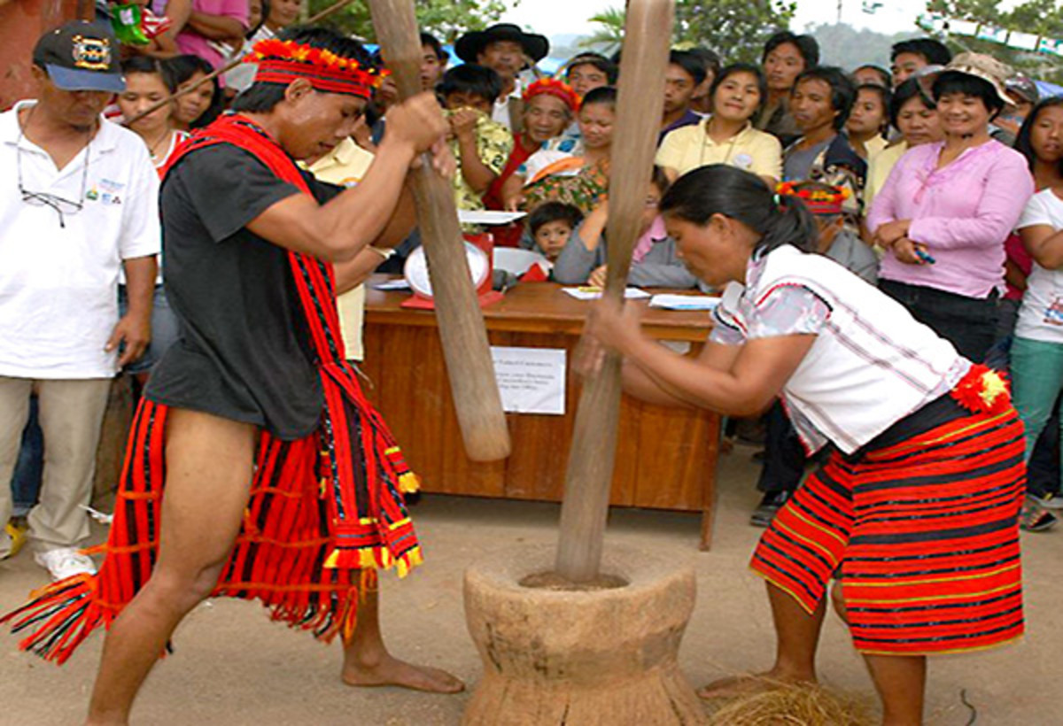 A giant mortar and pestle being used.
