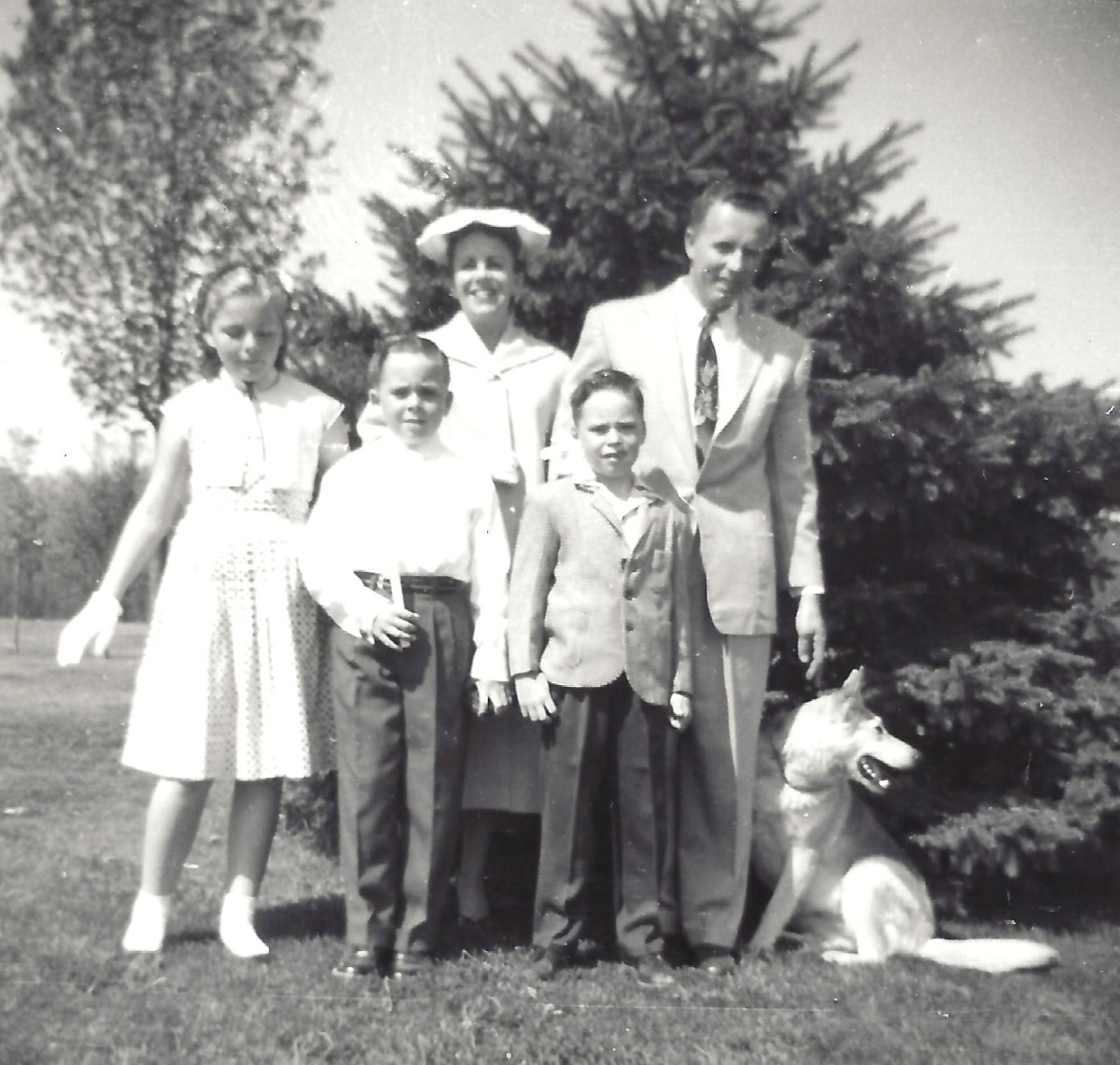My family in June of 1958.  My brother John is holding his first Holy Communion candle.