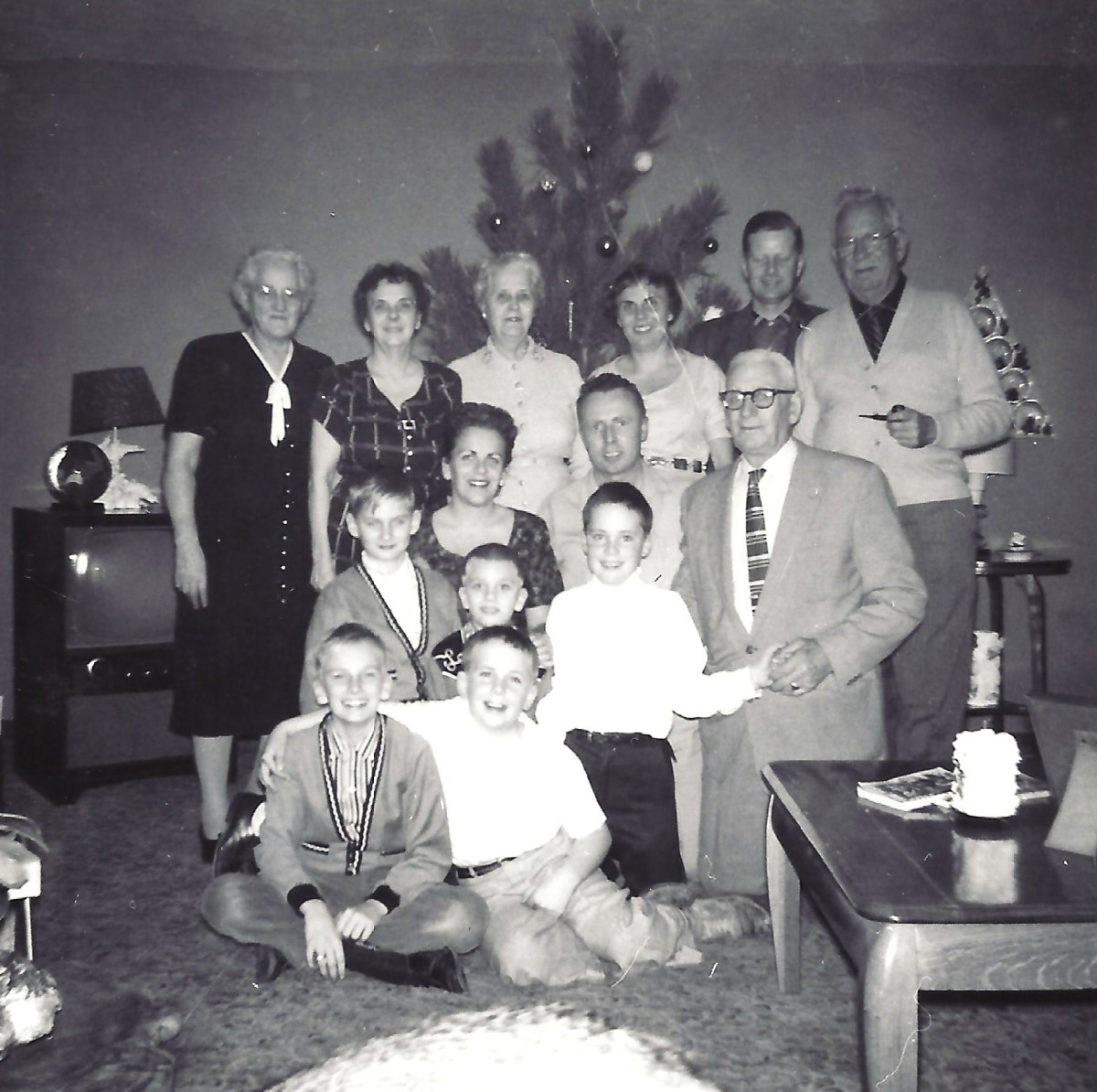 My family including maternal grandparents, great aunts and great uncle, aunt and uncle and cousins.  I took both photos with my Brownie camera.