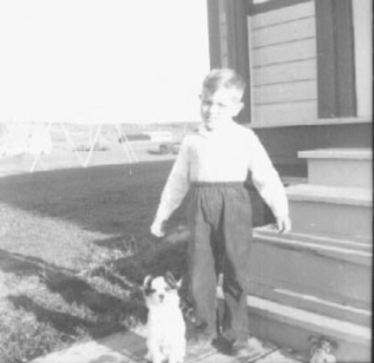 Bobby Hunter's first day of school. Most likely September 1954. Also in the picture: our dog Trixie