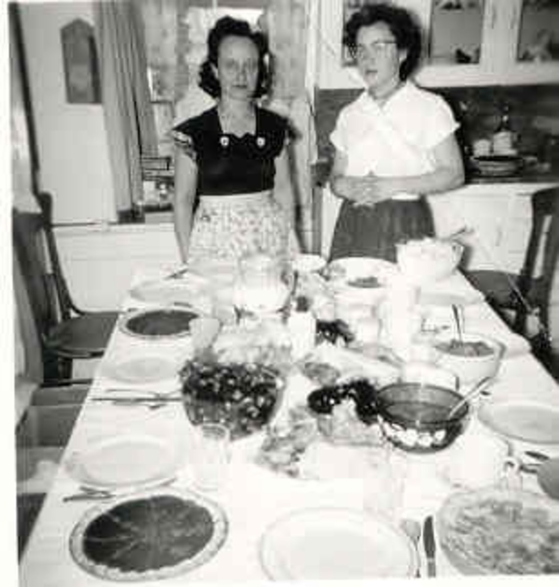 Mother and older sister preparing the holiday table