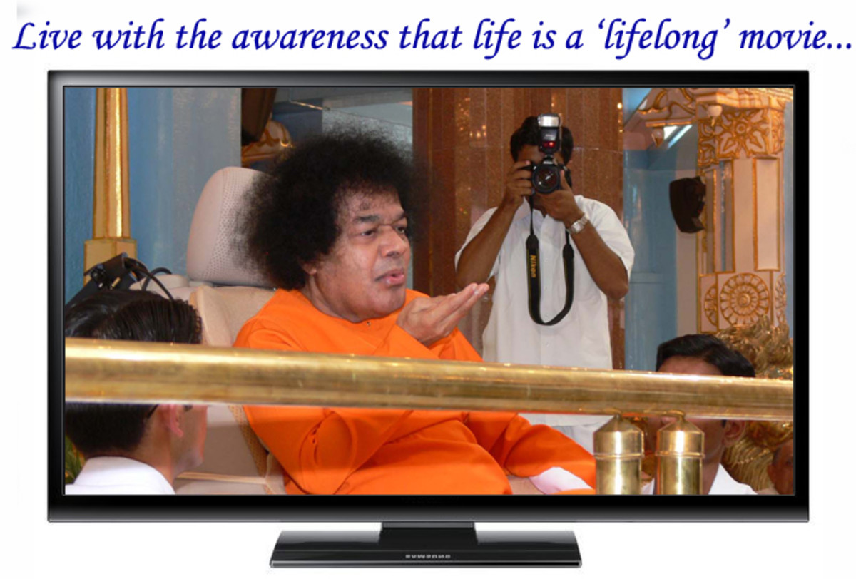 In the television: A beautiful moment when Swami materialized vibhuti and 'blew' it on all the students seated in the front.