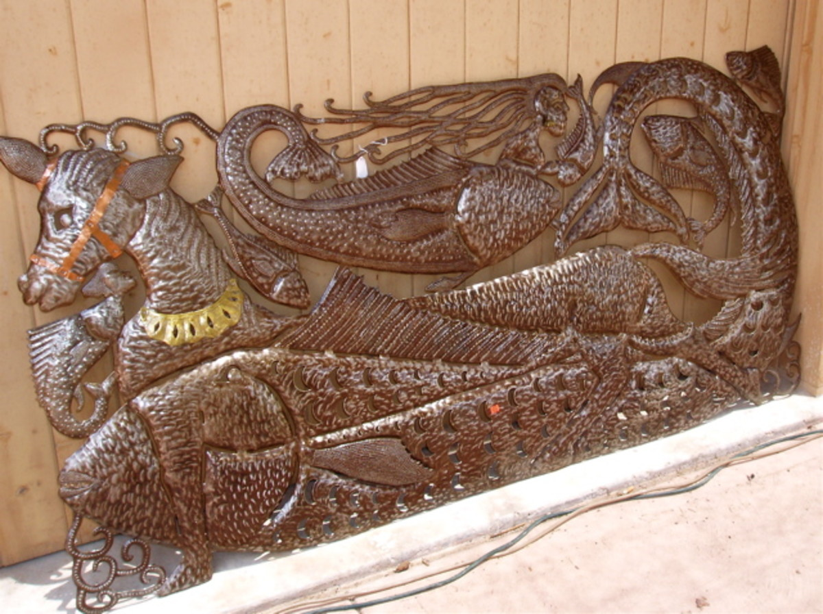 All of the art displayed by Haiti at the market was steel sculpture made from recycled steel (oil) drums. Here is a water dragon frolicking with ocean fish.