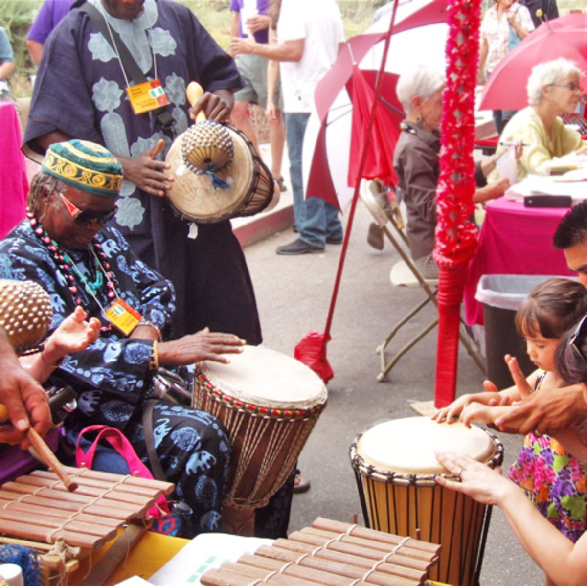 Drumming by Ghanaian drummers and anyone else who wants to.