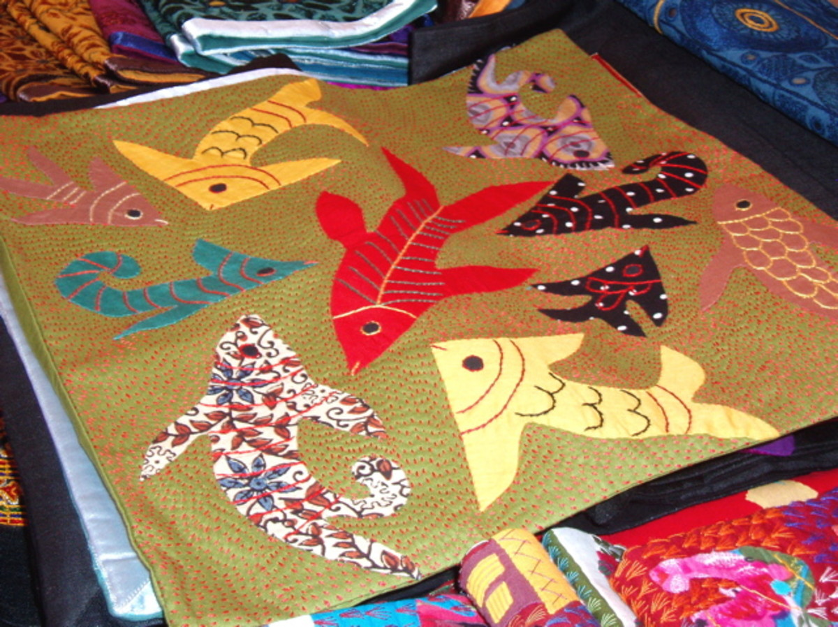 This fish panel was made in the state of Mexico (Central Mexico) by the Mazahuas - considered the poorest indigenous group in the state. They have a long handicraft tradition of making fine embroidery such as this.