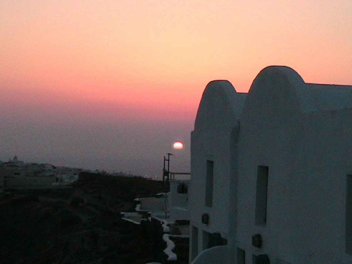 A Santorini sunset at Oai indicating the amount of pollution in the air in the Aegean