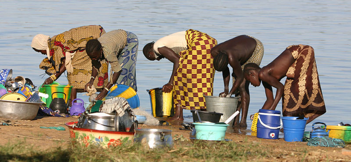 Nigerian mothers washing in the Niger.  Caribbean mothers also washed in the river.  Photo by Ferdinand Reus