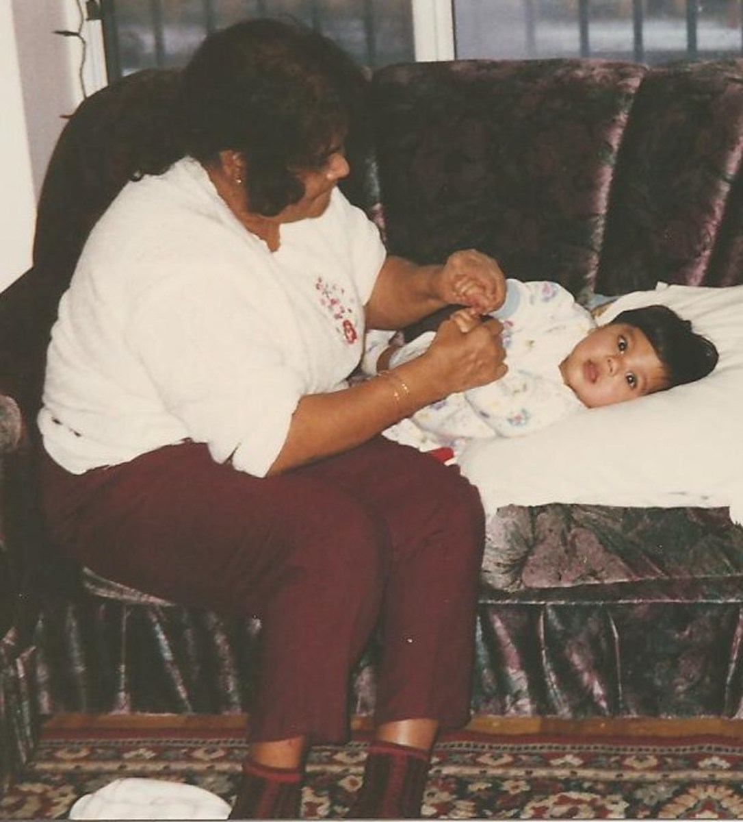 My son and his doting paternal grandmother. She loved playing with her Grand Children.