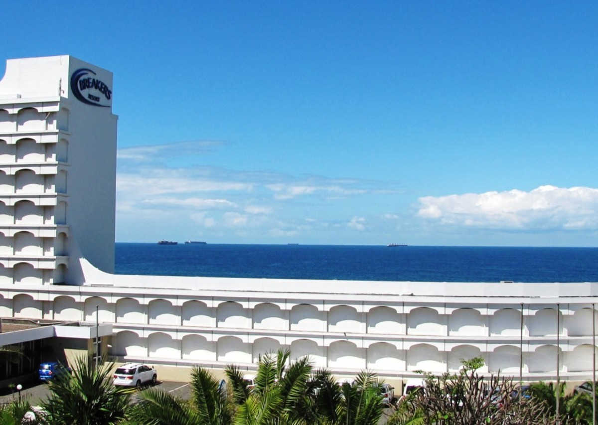 Playground of rich and famous: Umhlanga, Durban North-with ships waiting turn in harbor,