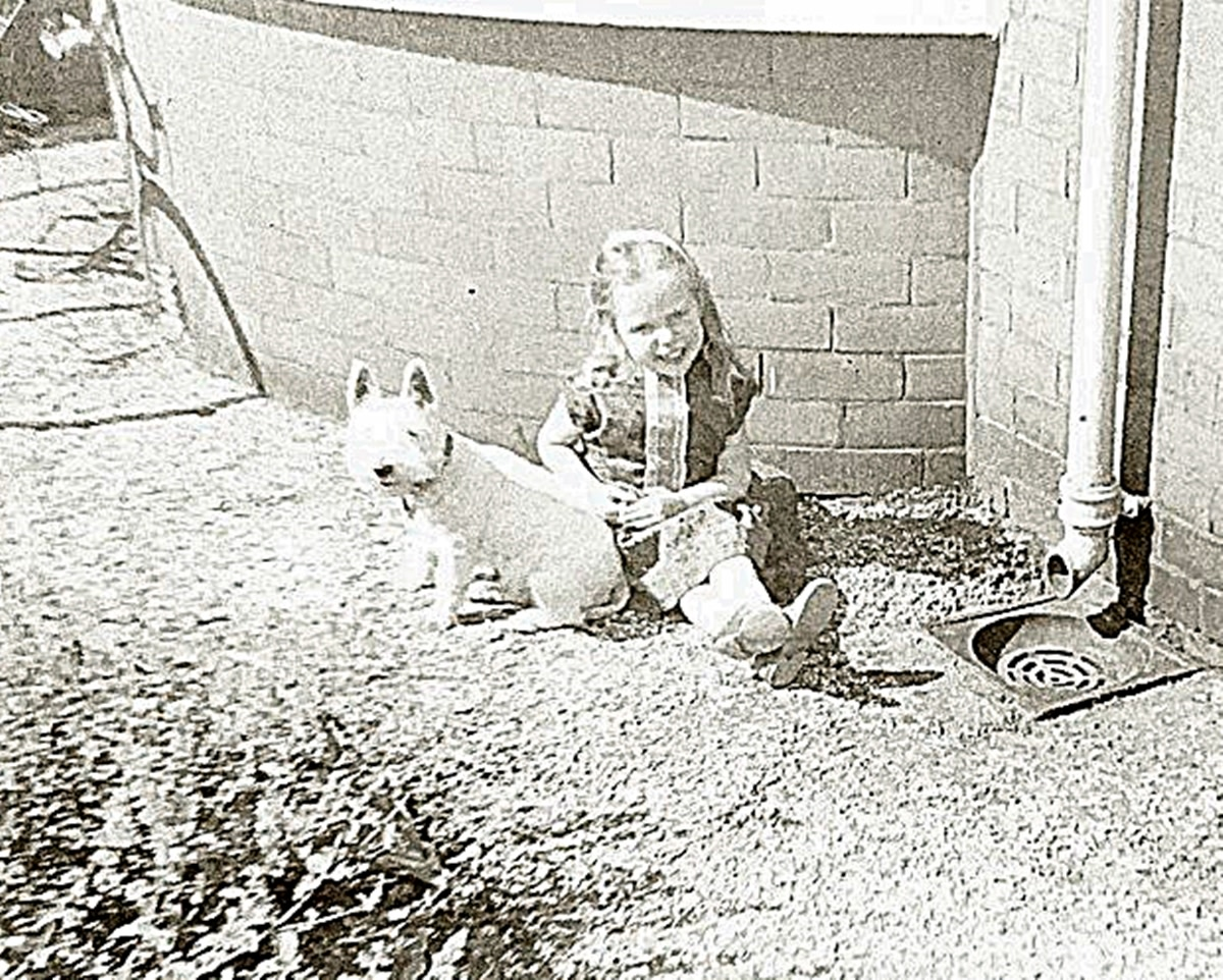 Me as a child with my first dog, Mitzie, in the 1970s.