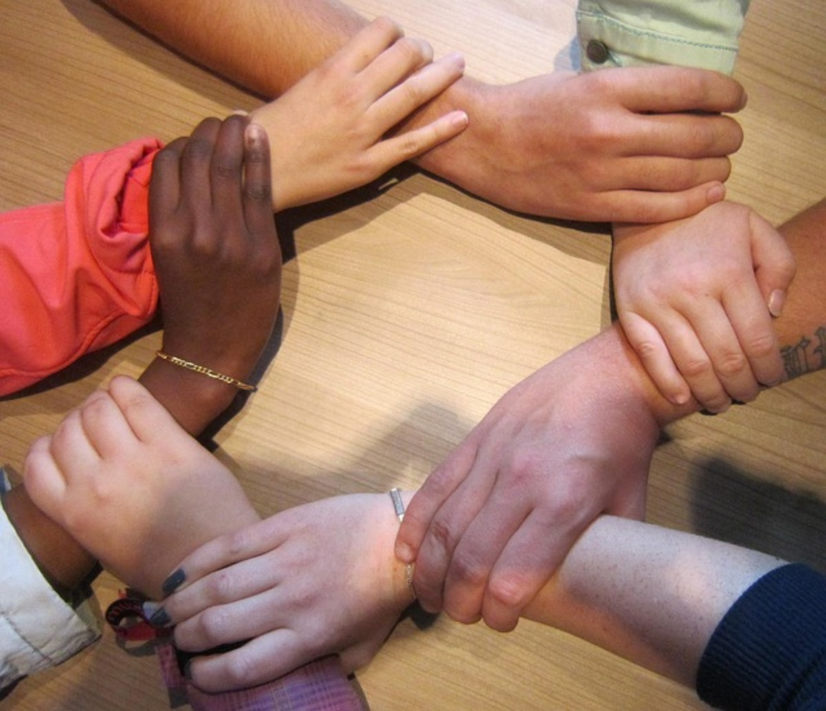 Hands are joined together, locked in love, symbolic of solidarity, diversity and acceptance.