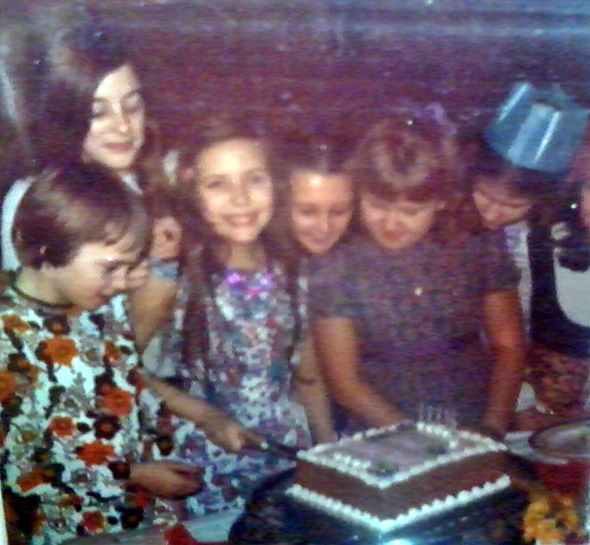 Me cutting my cake as I celebrated my 11th birthday, just before I started my first term at grammar school. I was such a shy little thing.