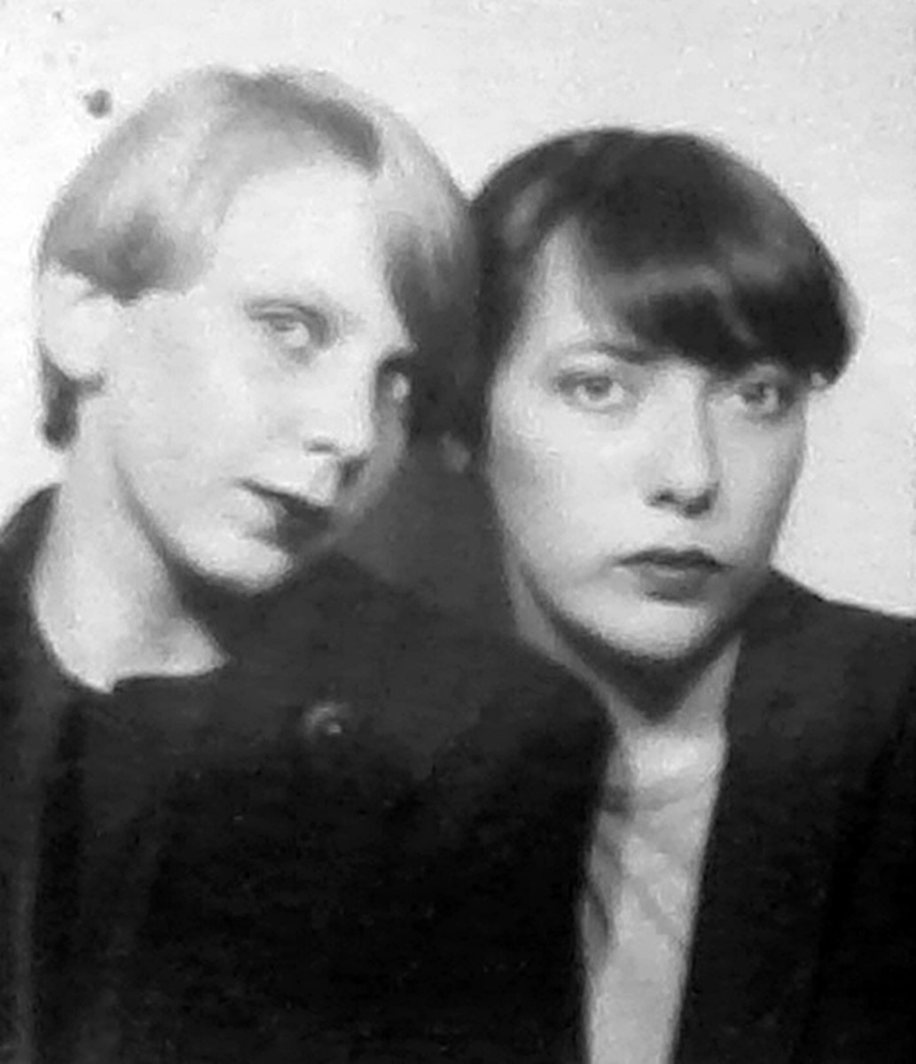 Pictured on the right, with a schoolfriend, I was in the fourth form when I had my long hair cut off. I had the sides of my hair cropped very short, but the top left longer.