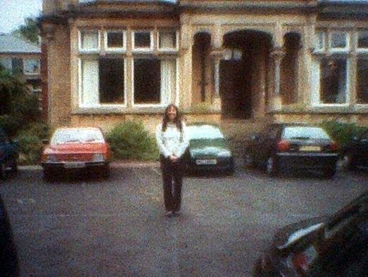 Me standing outside my old classrooms for the final time in the year 2000, when the school closed down.