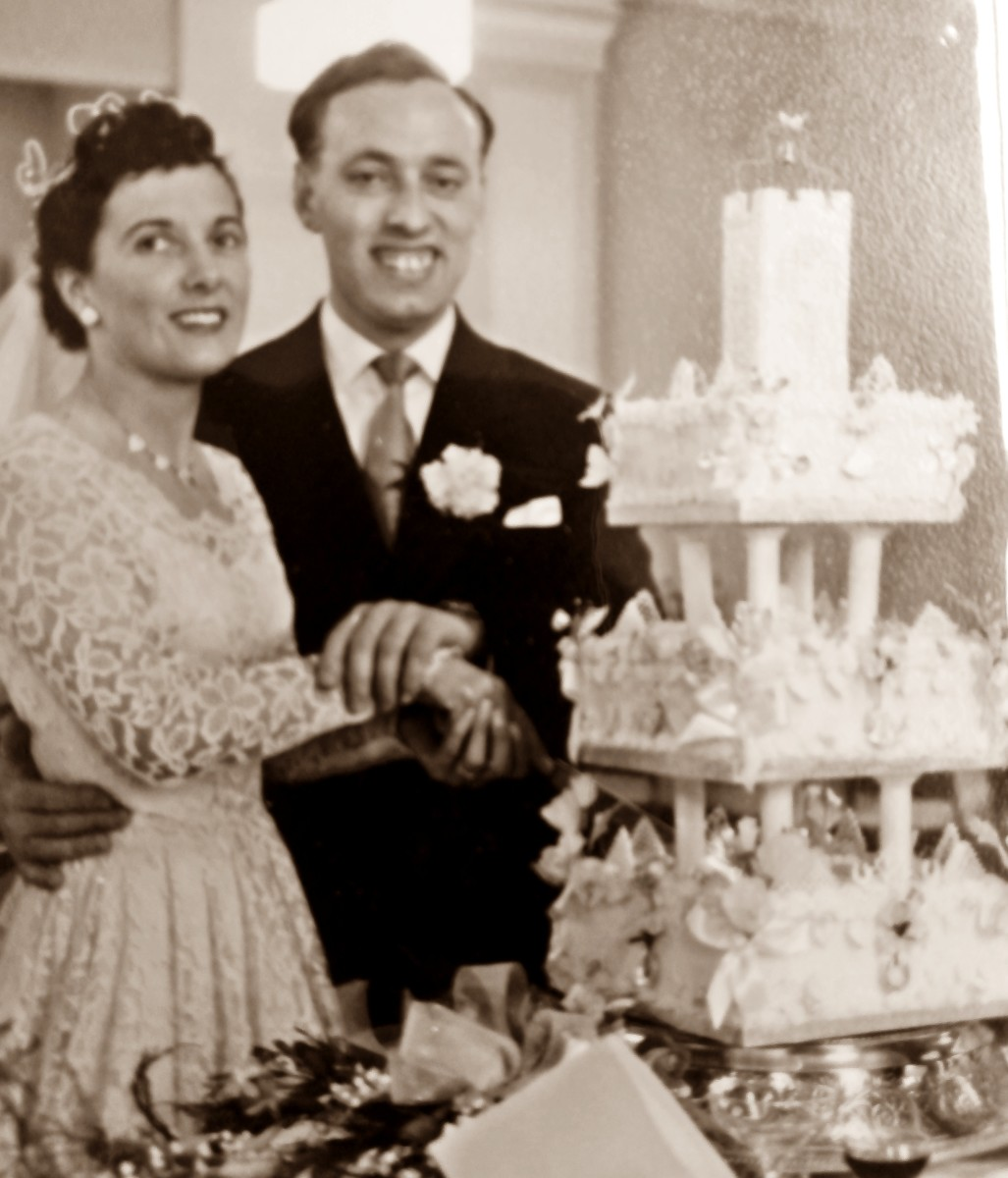 Cutting the cake at their wedding, 1957.