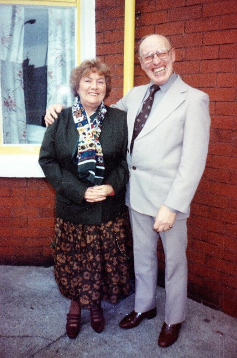 Mum and dad in their 'Sunday best' in the '90s, outside our house