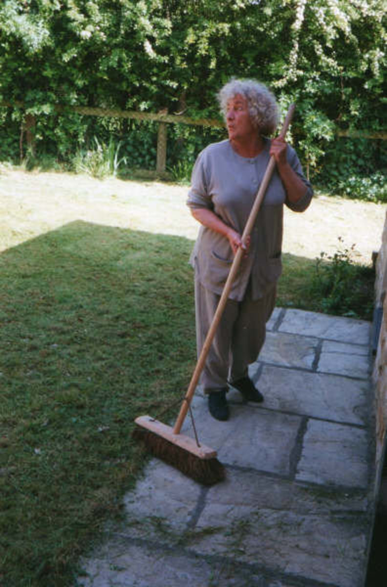 Mum sweeping my brother's garden (1990s) - the brush was much bigger than she was!