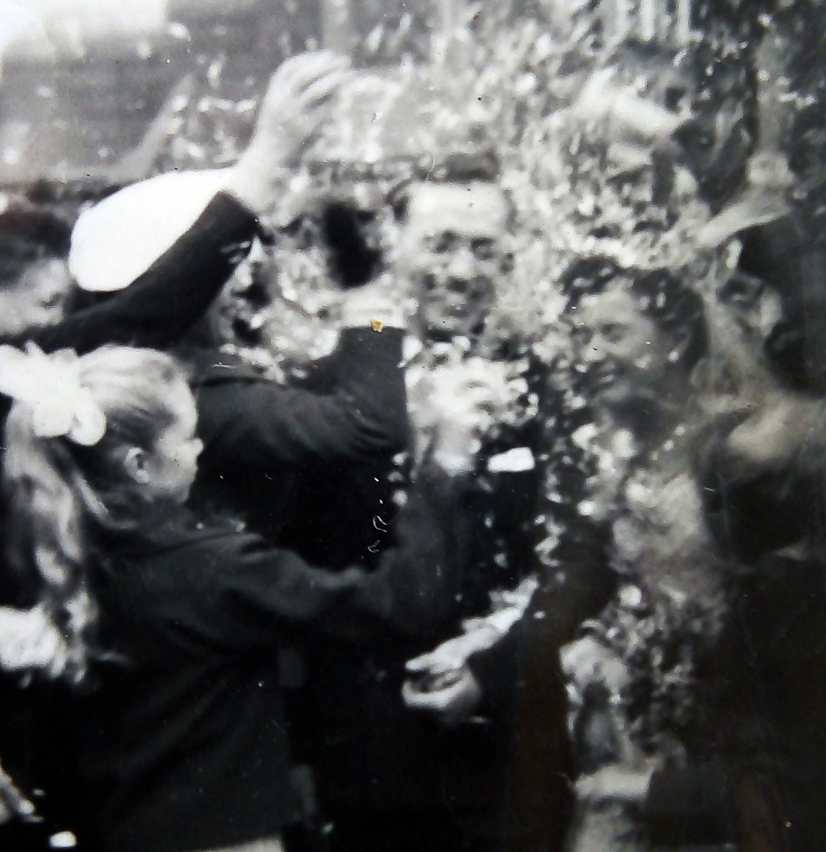 Throwing the confetti - mum and dad's wedding in 1957.