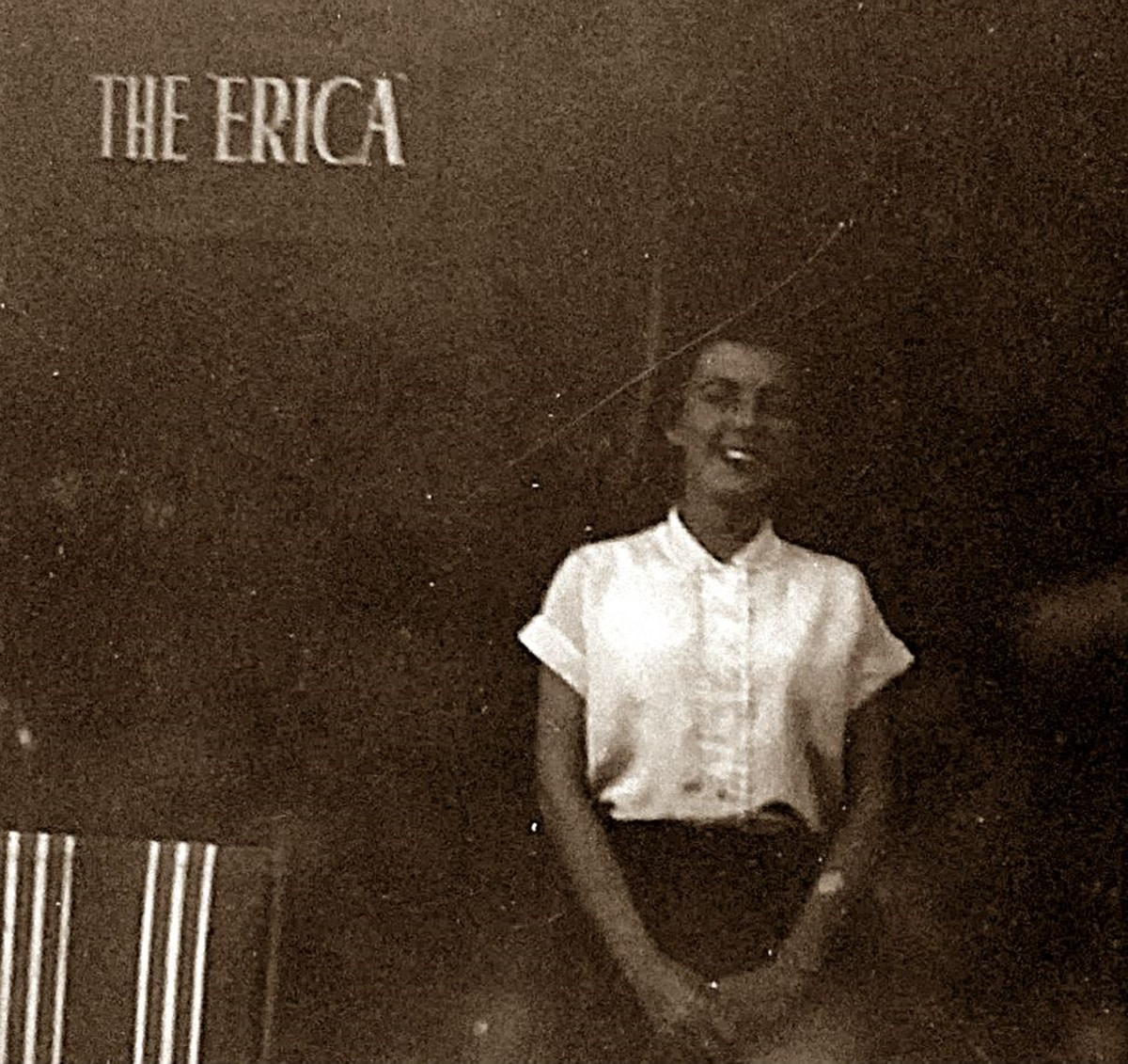 Mum as a young woman, posing outside grandma's B&B, The Erica.