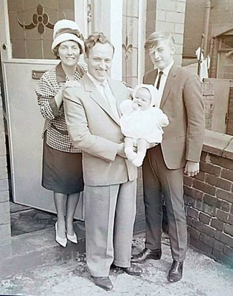 My christening day, with mum, dad and my brother Eric, outside our house