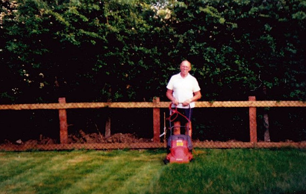 Dad mowing my brother's lawn in the 1990s