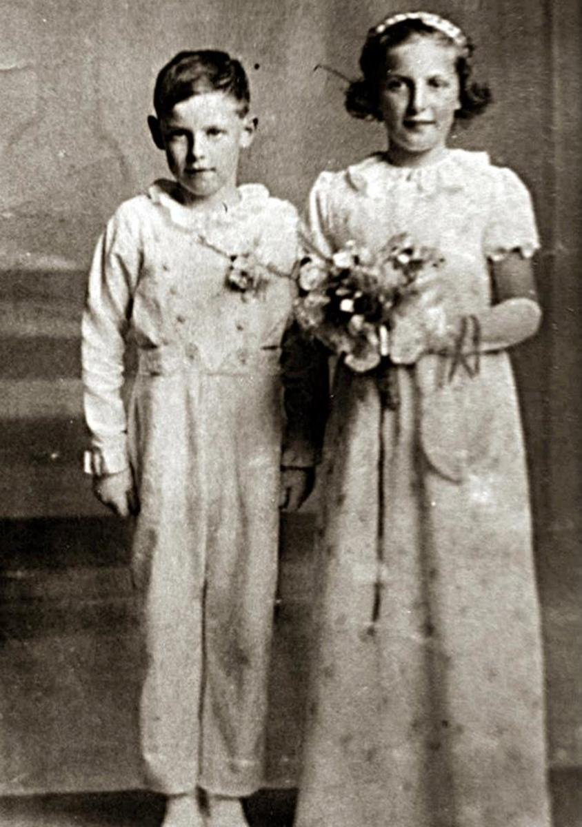 Mum and Kenneth as bridesmaid and pageboy at a family wedding.