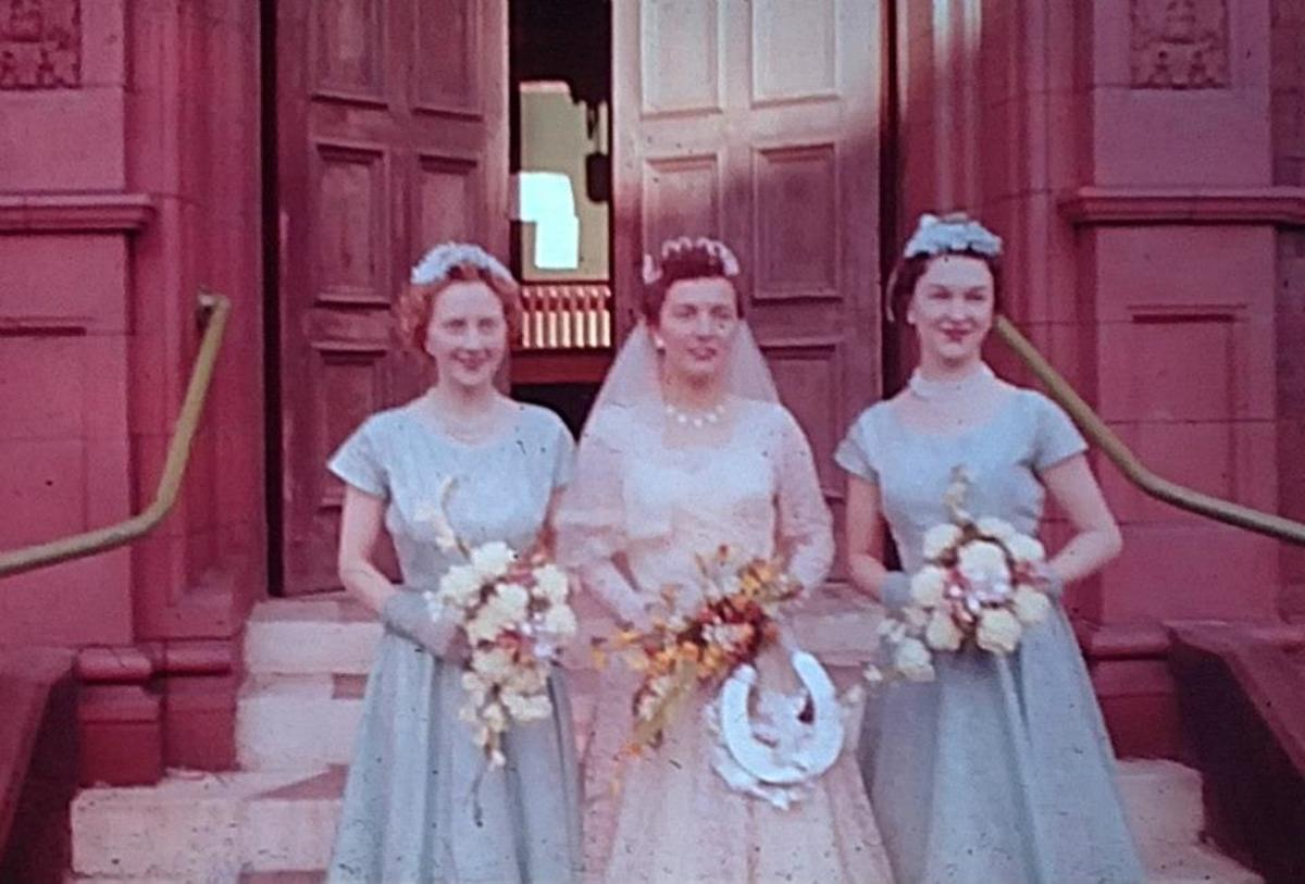 Mum resplendent in her wedding dress with her bridesmaids.