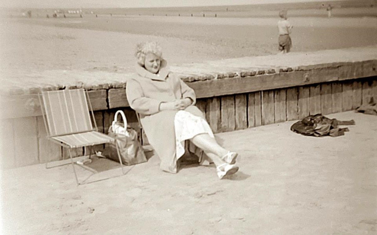Grandma's younger sister, Madge, enjoying relaxing on the seafront during a holiday.