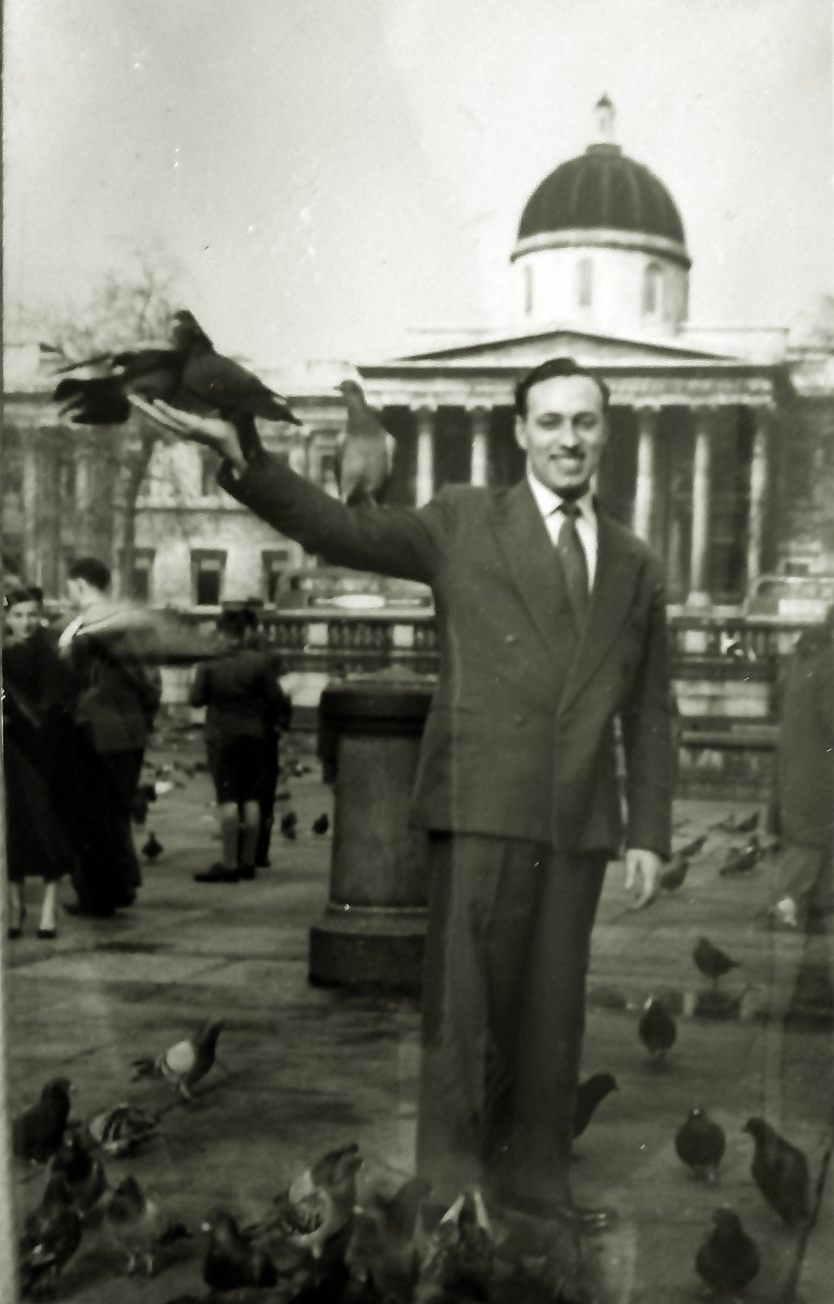 Dad on honeymoon in November 1957 - feeding the pigeons in Trafalgar Square.