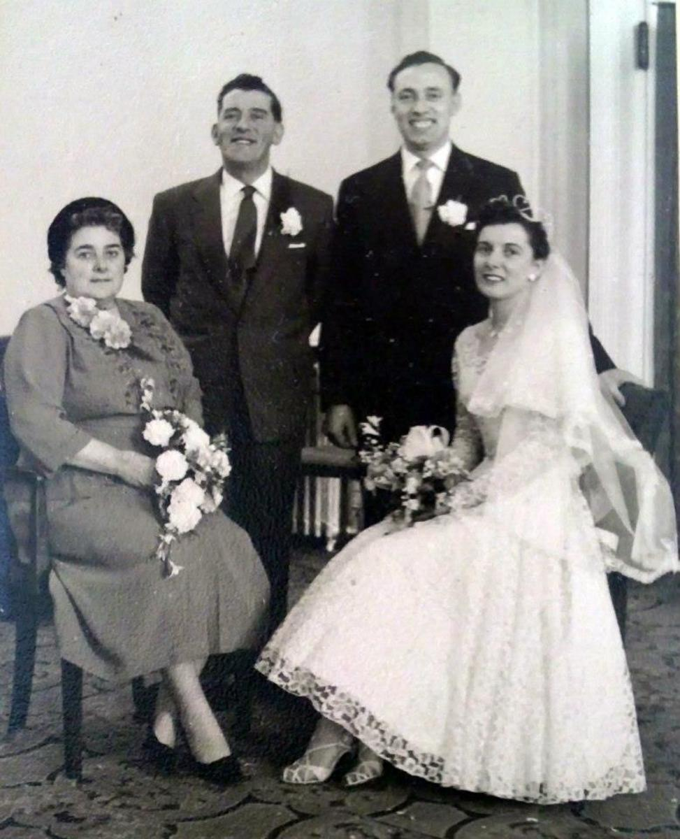 Mum and dad's wedding day: The happy couple are pictured with mum's parents, grandma Ivy and grandad Frank Trigg.