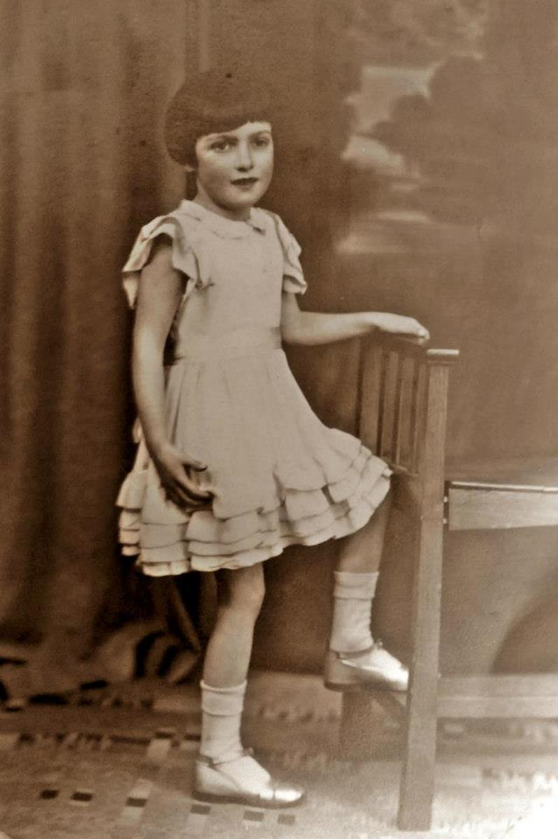 Mum as a child in a staged photograph at a studio.