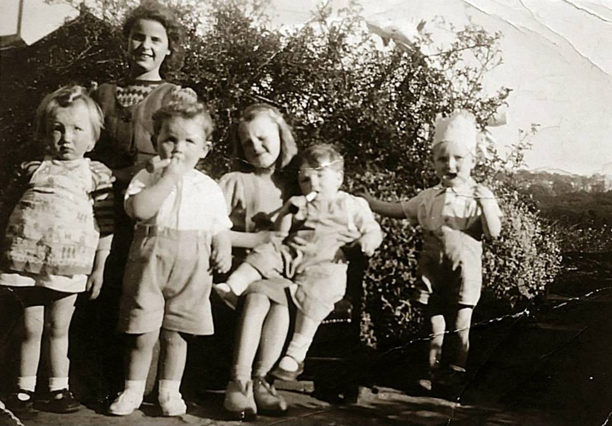 A family photo from around 1949: On the right is my brother Eric as a toddler, with my mum's cousins Shirley (standing at the back); Sandra (sitting on the bench) and Paul (standing at the front). The other two were neighbours' children.