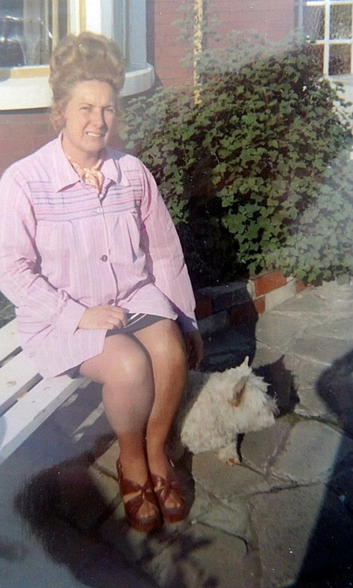 Mum in the 1970s (pictured with my dog, Mitzie, in the front garden. Mum worked in the office of a rock factory and had a gravity-defying hairstyle and wore the platform shoes of the era.