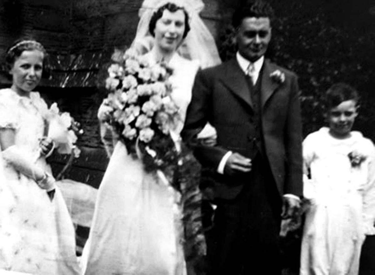 Mum and Ken as bridesmaid and pageboy at grandad's sister's wedding in the 1930s.