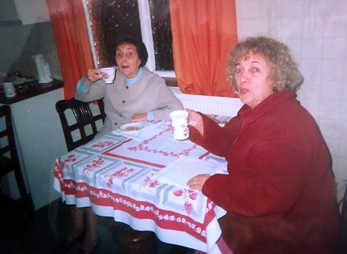 Cheers! Mum and Beryl enjoy a cup of tea in the '90s at our dining table