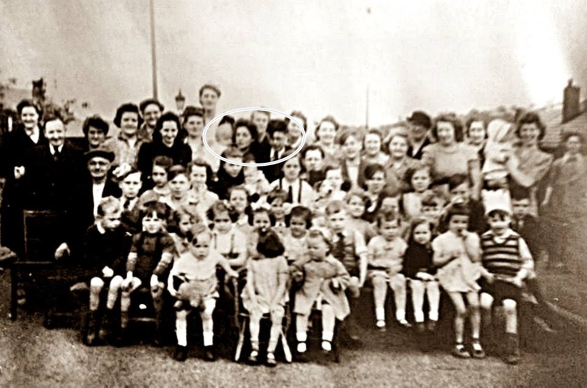 Street party to celebrate victory in Europe in May 1945. Mum is pictured holding a neighbour's toddler and standing next to her brother, Kenneth (circled in the photo, to the left of the centre at the back).