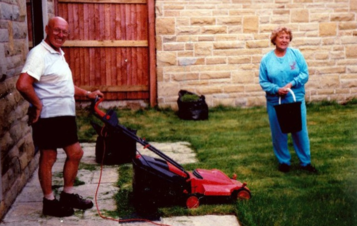 Dad and mum tending my brother's garden in the 1990s