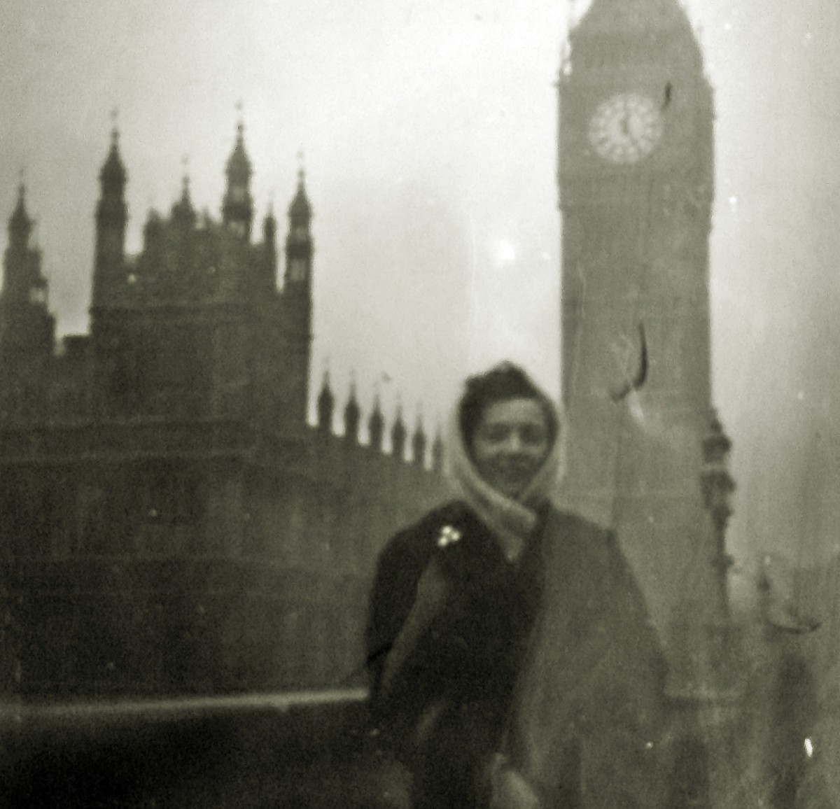 Mum on honeymoon standing in front of Big Ben - London, November 1957
