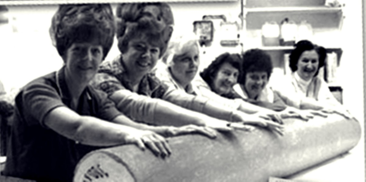 Rock rollers at Ashton Candy Co in the 1970s, when mum worked there, pictured with the official Biggest Stick of Rock in the World, which they made. Mum was friends with Yvonne (second left).