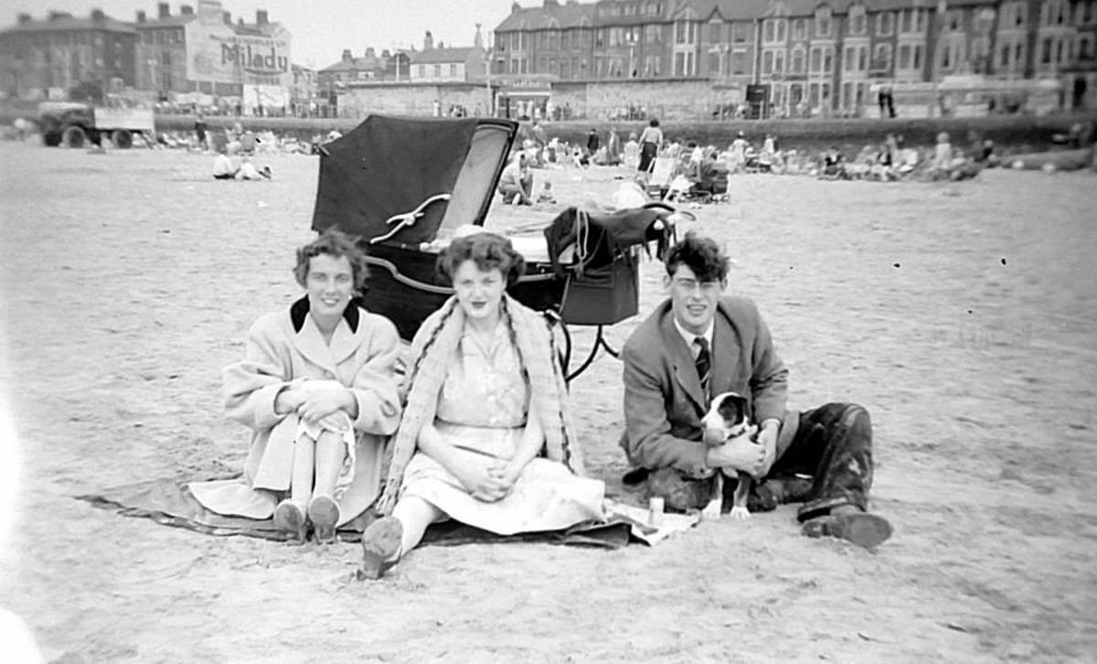 Pictured on Blackpool beach are mum on the left; her sister-in-law Anne in the centre and her brother Ken on the right, with their baby son Martin in the pram and their cute puppy. Ken and Anne were on holiday in Blackpool.