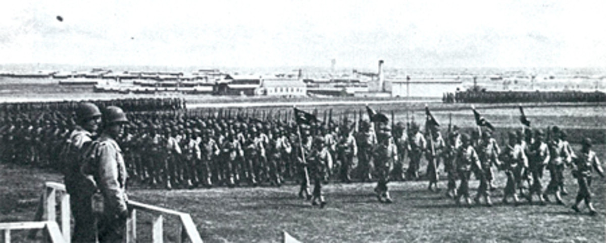 Review of troops at Camp Howze in Gainesville Texas during World War 2.