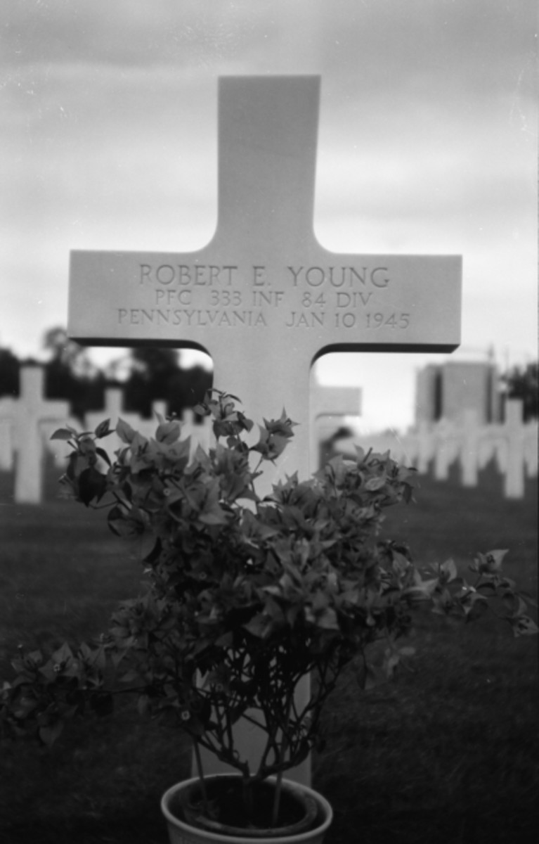 The grave marker for Pfc. Robert E. Young who was killed in action 10 Jan 45.