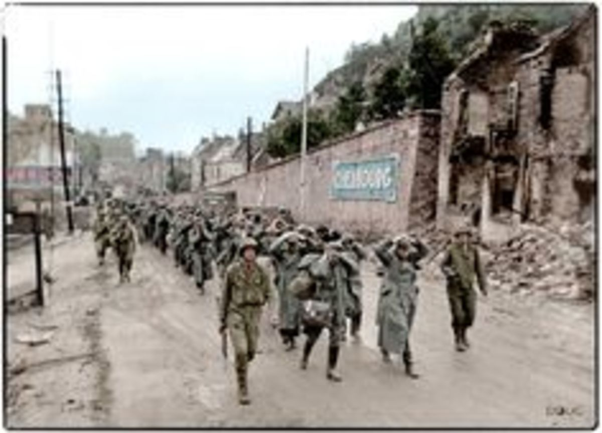 84th Division escorting captured German prisoners.