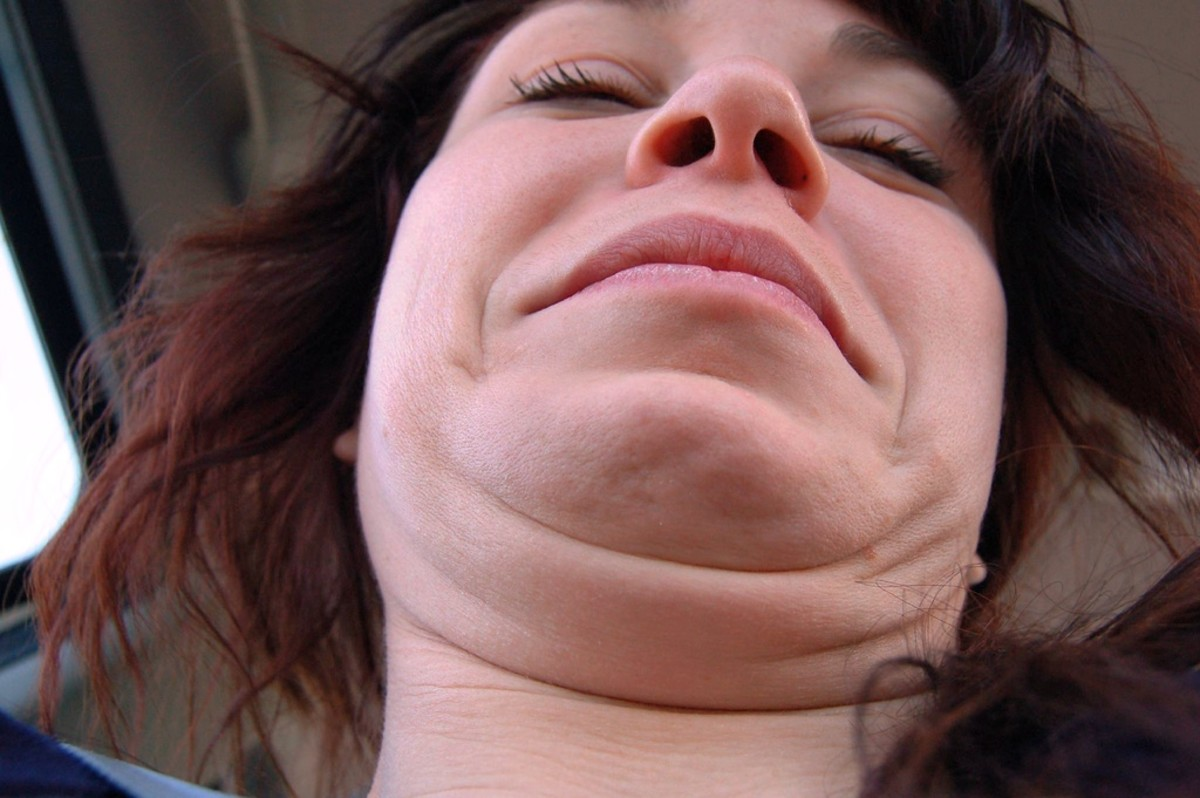 Double chins can happen to anyone, especially when you're taking a photo from an upward angle.  What cruel person would do that?  Take the photo from above.