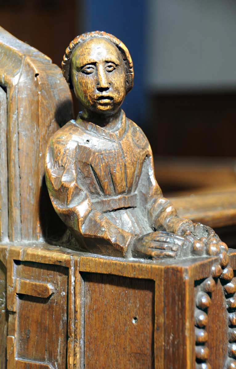 The wife of the Pedlar carved in wood - Swaffham Church